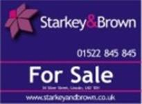 Logo of Starkey & Brown